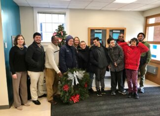 Evergreen Center presents Christmas wreath to Hopkinton