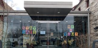 Hopkinton Public Library signs show support for town