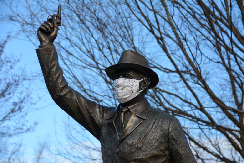 The Starter statue with protective mask