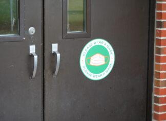 Mask sign on HMS door